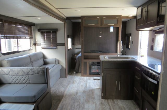 "This model of the CrossRoads Zinger travel trailer has room for the extended family and sleeps up to 11 people. The exterior features include 2 slideouts, double doors, a power tongue jack, an outdoor kitchen, and exterior shower. There's also an awning, skylight, and power roof vent. This travel trailer measures 36'6"" long and is fully stocked on features."